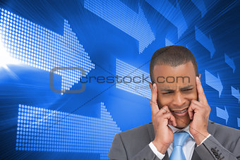 Composite image of businessman putting his fingers on his temples