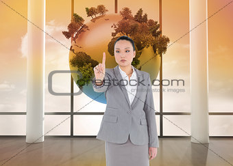 Composite image of unsmiling businesswoman pointing