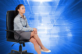 Composite image of portrait of a businesswoman sitting on an armchair