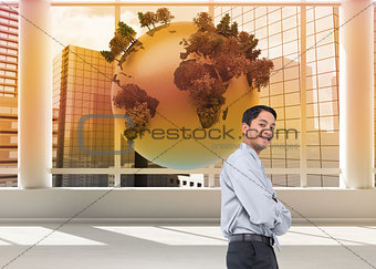 Composite image of smiling businessman
