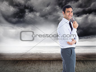 Composite image of businessman holding glasses