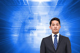 Composite image of businessman looking at camera