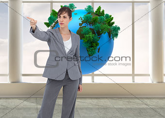 Composite image of businesswoman pointing to something