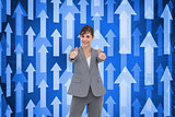 Composite image of businesswoman giving thumbs up