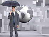 Composite image of businessman holding grey umbrella