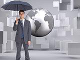 Composite image of businessman holding grey umbrella