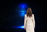 Composite image of businesswoman walking away from camera