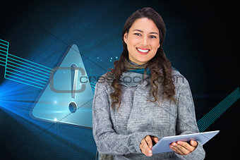 Composite image of model wearing winter clothes holding her tablet