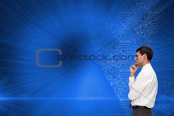 Composite image of young businessman looking away