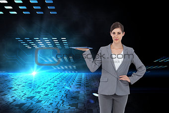 Composite image of businesswoman holding tablet pc