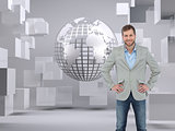 Composite image of man smiling with hands on hips
