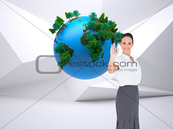 Composite image of businesswoman showing an okay gesture