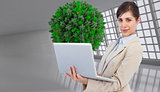 Composite image of young businesswoman with laptop