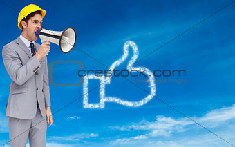 Composite image of architect yelling with a megaphone