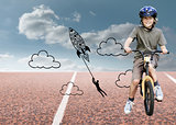 Composite image of boy with his bike