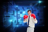 Composite image of businessman with his boxing gloves