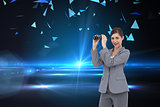 Composite image of businesswoman with binoculars
