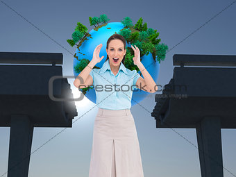 Composite image of surprised businesswoman posing
