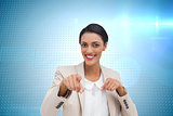 Composite image of businesswoman pointing at the camera