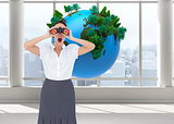 Composite image of shocked businesswoman looking through binoculars