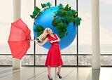 Composite image of blonde holding umbrella