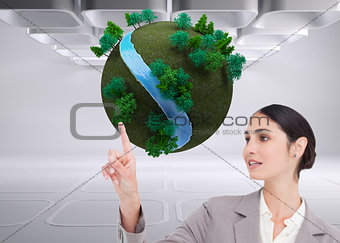 Composite image of saleswoman operating touchscreen
