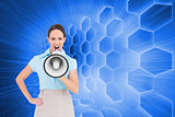 Composite image of furious businesswoman talking in megaphone