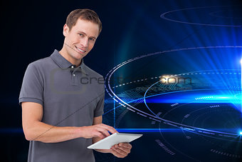 Composite image of young man with tablet computer