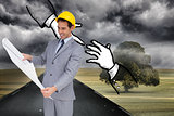 Composite image of architect with hard hat looking at plans