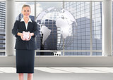 Composite image of happy businesswoman holding a piggy bank