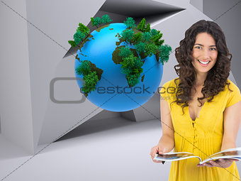 Composite image of curly haired brunette reading magazine