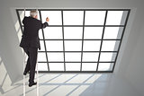 Composite image of businessman climbing career ladder