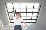 Composite image of businesswoman throwing binoculars away