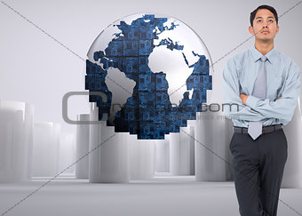 Composite image of serious businessman