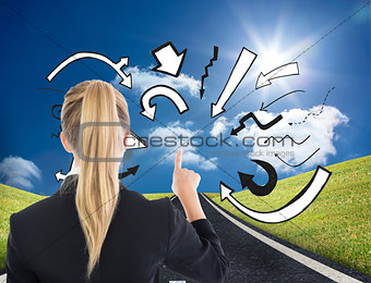 Composite image of business woman pointing