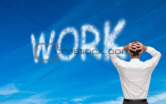 Composite image of businessman standing hands on head