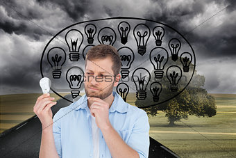 Composite image of model holding a bulb