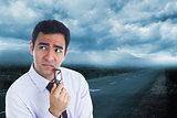 Composite image of businessman holding glasses