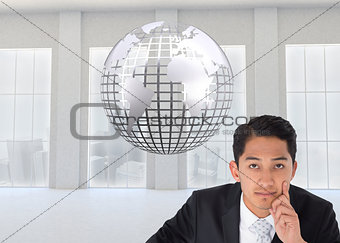 Composite image of thoughtful businessman