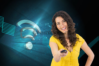 Composite image of curly haired pretty woman changing channel with remote