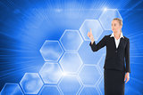 Composite image of blonde businesswoman pointing