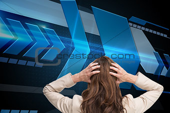 Composite image of young businesswoman with hands on head standing back to camera