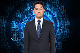 Composite image of businessman against shiny spiral of binary code