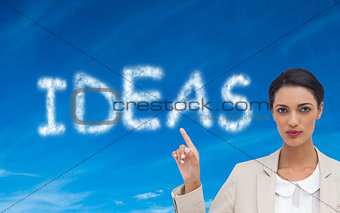 Composite image of businesswoman with hands up