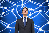 Composite image of businessman against glowing dots connected with lines