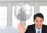 Composite image of smiling businessman holding hand up