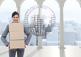 Composite image of businesswoman carrying cardboard boxes