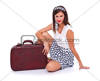 Posing with suitcase