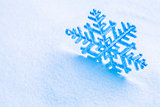 Snowflake on the snow. White xmas holiday background.
