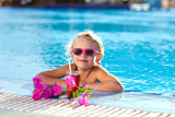 girl drinking coctail in the pool